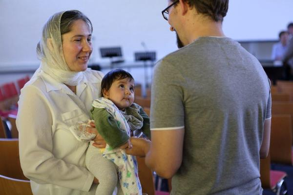 A refugee family meets with Gordy